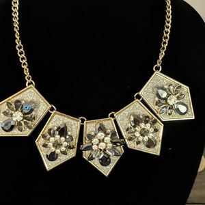 Necklace with gray and silver crystal stones